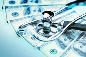 stethoscope on top of hundred dollar bills